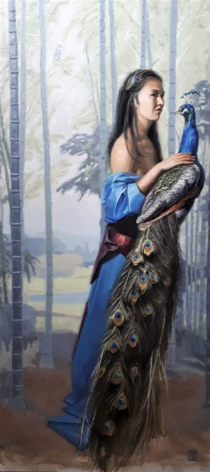 Korean girl with peacock in tropical wood. She is wearing a blue dress.