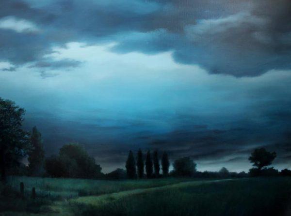 'Innerglow' Een nachtelijk landschap met hoge bomen en opening tussen de donkere wolken.